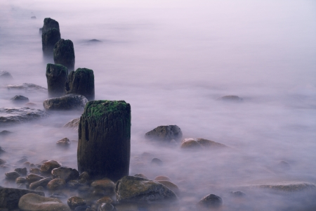 sea old breakwater with wet stones Stock Photo - 15845575