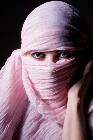 woman with blue eyes in pink hijab looks in camera Stock Photo - 17605960