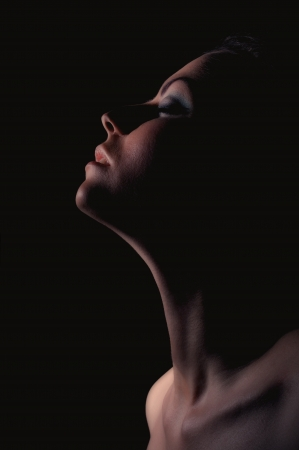 sensuality pensive girl profile with closed eyes in moonlight dark