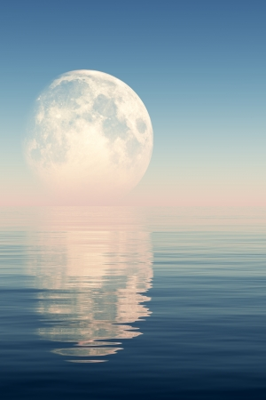 full moon behind sea in pink light   photo