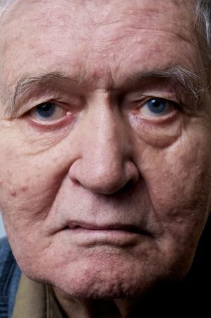 old man face closeup eyes looks at camera