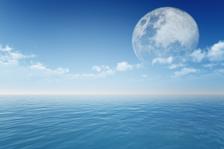 full moon behind sea in clouds  photo
