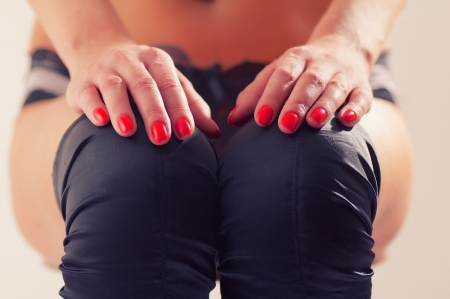 hands with manicure at knees and naked thighs