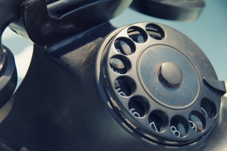 old fashioned rotary phone: old black retro telephone disk dealer
