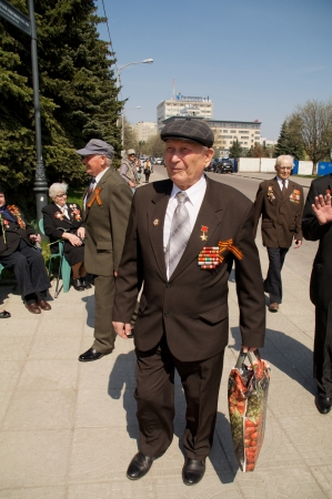 elder tree: Kaliningrad, Russia - May 05, 2013 - veteran of the World War with his medals walk at street on during the victory celebration