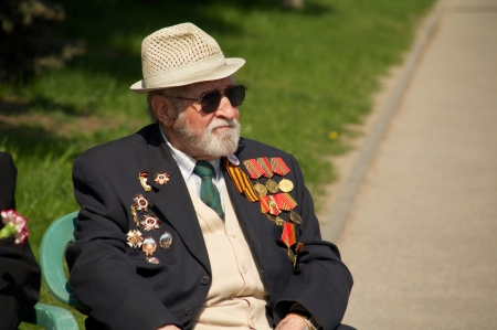 elder tree: Kaliningrad, Russia - May 05, 2013 - veteran of the World War with his medals at street on during the victory celebration Editorial