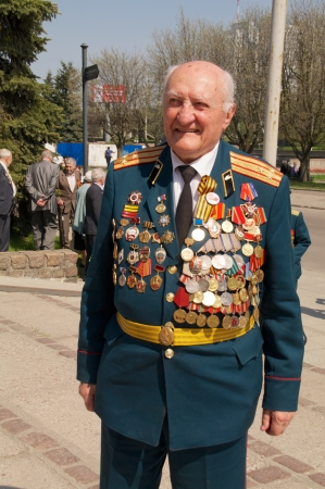 elder tree: Kaliningrad, Russia - May 05, 2013 - veterans of the World War with medals walk at street on during the victory celebration