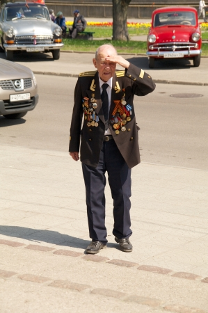elder tree: Kaliningrad, Russia - May 05, 2013 - veteran of the World War with medals walk at street on during the victory celebration Editorial