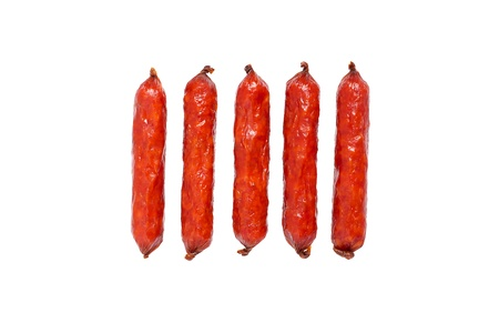 Sausages isolated over a white background photo