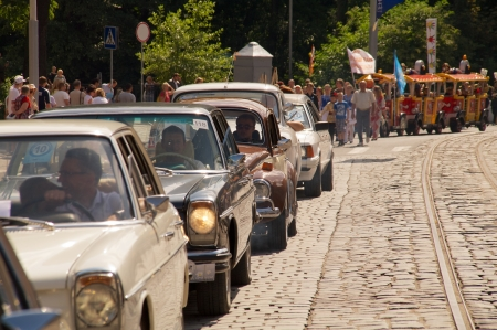 developing country: KALININGRAD, RUSSIA - JULY 14: people and retro cars walks on street on City Day of Kaliningrad celebration on July 14, 2013 in Kaliningrad, Russia