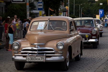 developing country: KALININGRAD, RUSSIA - JULY 14: people and retro cars on street on City Day of Kaliningrad celebration on July 14, 2013 in Kaliningrad, Russia