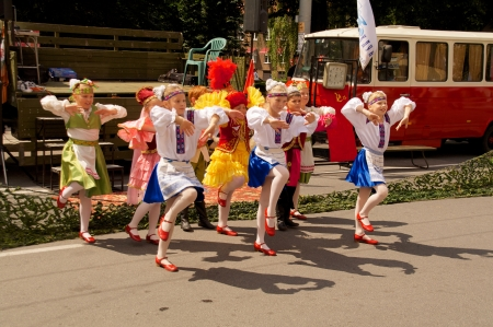danced: KALININGRAD, RUSSIA - JULY 14: children in national dress danced on the street on City Day of Kaliningrad celebration on July 14, 2013 in Kaliningrad, Russia