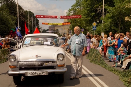 developing country: KALININGRAD, RUSSIA - JULY 14: man with old retro car \Volga GAZ 21\ on the street on City Day of Kaliningrad celebration on July 14, 2013 in Kaliningrad, Russia