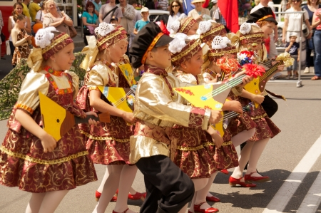 danced: KALININGRAD, RUSSIA - JULY 14: children in russian national dress sang and danced on the street on City Day of Kaliningrad celebration on July 14, 2013 in Kaliningrad, Russia
