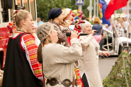 danced: KALININGRAD, RUSSIA - JULY 14: women in national dress sang and danced on the street on City Day of Kaliningrad celebration on July 14, 2013 in Kaliningrad, Russia