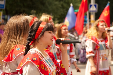 danced: KALININGRAD, RUSSIA - JULY 14: girls in russian national dress sang and danced on the street on City Day of Kaliningrad celebration on July 14, 2013 in Kaliningrad, Russia