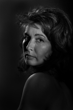 over the shoulders: sad serious mature woman looking over shoulder monochrome Stock Photo
