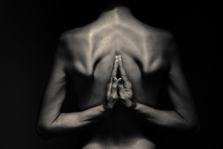 woman back with arms in yoga asana position monochrome image photo