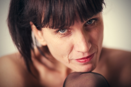 mature sensuality woman face closeup photo
