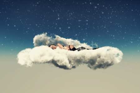 girl in black lingerie lies on a cloud sleeps