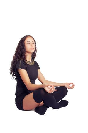pretty girl in cross-legged meditation pose