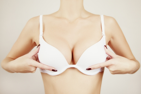 girl showing breast in white bra Stock Photo