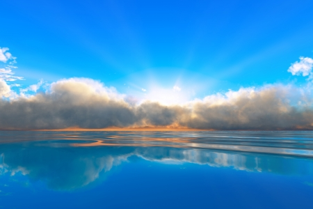 sun rays in clouds over tranquil ocean sunset