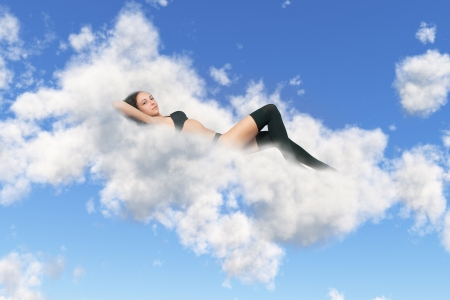 girl in black lingerie lies on a cloud photo