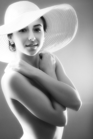 bare girl in straw hat vintage style image monochrome photo