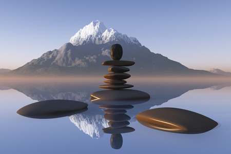 stacked stones in lake water on mountain background