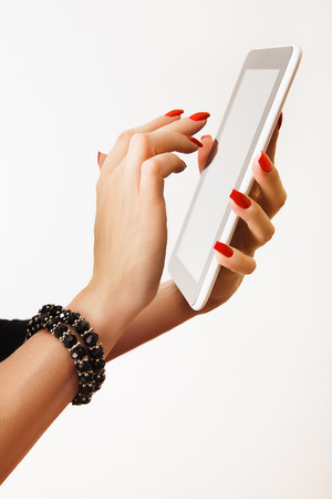 female hands with tablet PC photo