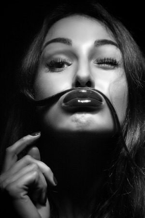 Fun Young Woman Using her hair as a Mustache monochrome image photo