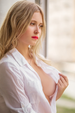 bare breasts: pretty young woman shows naked perfect breast