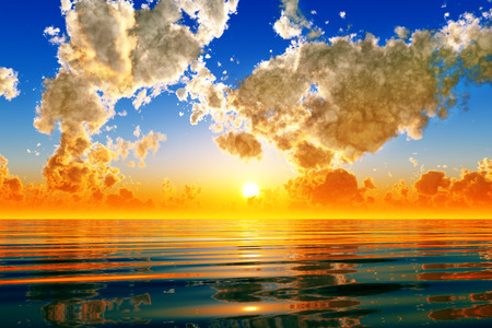 dramatic sunset in puffy clouds over sea photo