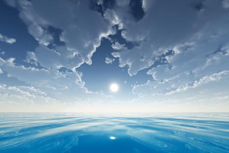sun in clouds over blue sea photo