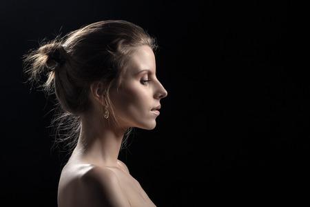 naked black woman: perfect female profile on black background