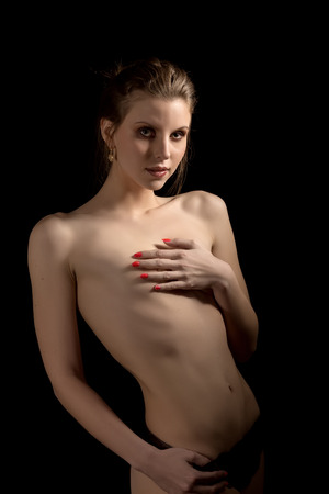 woman with small breast covering her naked body
