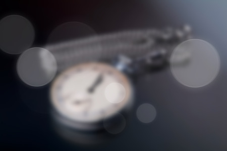 pocketwatch: old rusted pocket watches blurred background