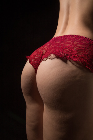 unrecognizable female buttocks with cellulite
