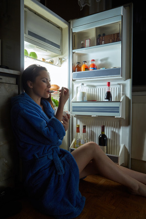 woman night: woman eating dessert in refrigerator