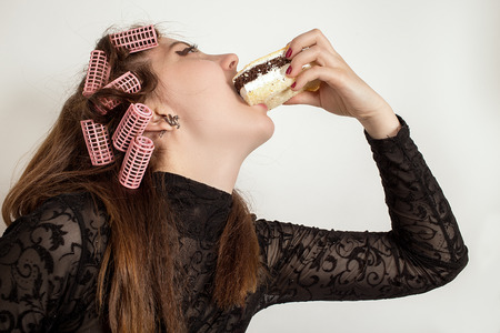 gluttonous: Young hungry gluttonous woman eating pie Stock Photo