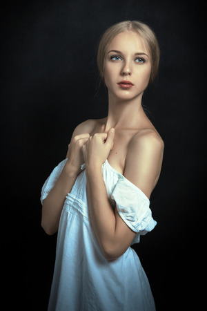 bared: sensual young woman in white dress with bared shoulders