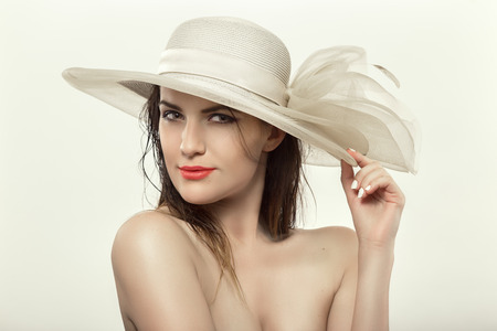 hat nude: beautiful naked woman in white hat, toned image