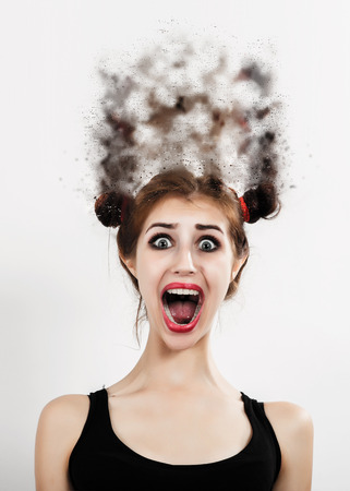 shout: fun shocked woman screaming on white background