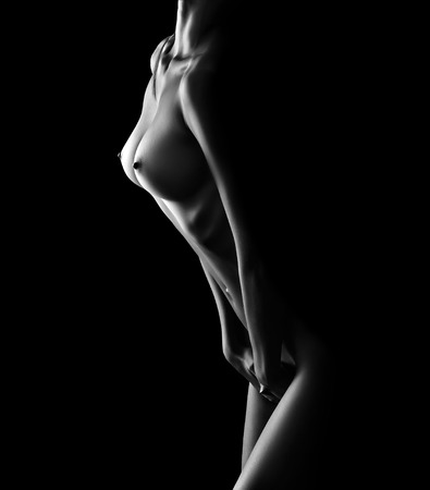 nude women: beautiful naked female body on black background