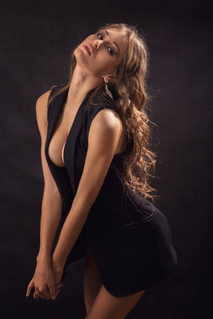 big breast: pretty sensual young woman posing on black background Stock Photo