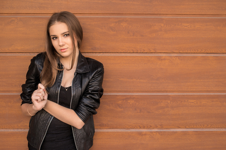 copyspace: serious girl near wall with copyspace Stock Photo