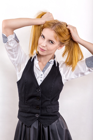 sexy young girl: fun girl with yellow hair posing on white background Фото со стока