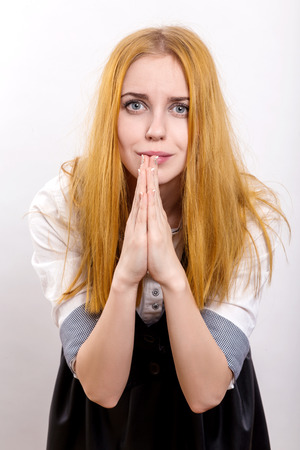 pretty woman in praying pose on white background