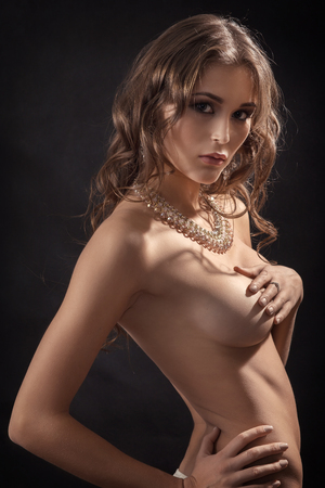 luxury naked woman covering her big breasts